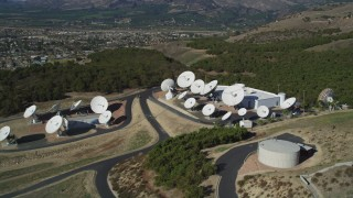 DFKSF01_009 - 5K stock footage aerial video of flying by satellite dishes in the hills, Fillmore, California