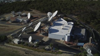 DFKSF01_010 - 5K stock footage aerial video of orbiting a building with several satellite dishes in the hills, Fillmore, California