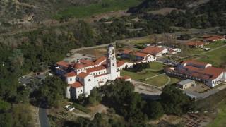 DFKSF01_015 - 5K stock footage aerial video of orbiting the Thomas Aquinas College campus, Santa Paula, California