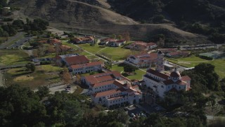 DFKSF01_016 - 5K stock footage aerial video of flying by the Thomas Aquinas College campus, Santa Paula, California