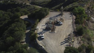 DFKSF01_017 - 5K stock footage aerial video of orbiting oil rigs on a hilltop, Santa Paula, California