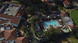 DFKSF01_025 - 5K stock footage aerial video of tilting to a bird's eye view by the pool area at Ojai Valley Inn and Spa hotel, Ojai, California