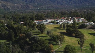 DFKSF01_026 - 5K stock footage aerial video of a wider view of the Ojai Valley Inn and Spa hotel, Ojai, California