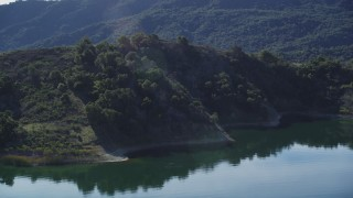 DFKSF01_028 - 5K stock footage aerial video of approaching hills on the shore and flying over, Lake Casitas, California