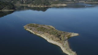 DFKSF01_031 - 5K stock footage aerial video of flying over a small peninsula in Lake Casitas, California