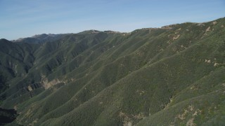 DFKSF01_037 - 5K stock footage aerial video of approaching mountains, revealing second range, Santa Ynez Mountains, California