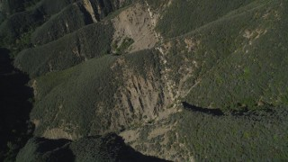 DFKSF01_038 - 5K stock footage aerial video of bird's eye view flying over scarred mountainside, Santa Ynez Mountains, California