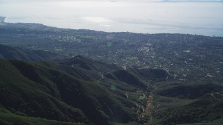 DFKSF01_039 - 5K stock footage aerial video of flying over a mountain, revealing Santa Barbara, Santa Ynez Mountains, California