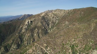 DFKSF01_040 - 5K stock footage aerial video of approaching the scarred sides of mountains, Santa Ynez Mountains, California