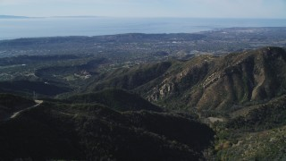 DFKSF01_041 - 5K stock footage aerial video approach jagged mountainsides, reveal Santa Barbara, Santa Ynez Mountains, California