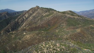 DFKSF01_042 - 5K stock footage aerial video of flying over rocky slopes in the Santa Ynez Mountains, California