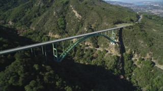 DFKSF01_048 - 5K stock footage aerial video of approaching the Cold Springs Canyon Arch Bridge, Santa Ynez Mountains, California