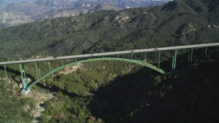 DFKSF01_049 - 5K stock footage aerial video of flying by the Cold Springs Canyon Arch Bridge, Santa Ynez Mountains, California