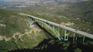 DFKSF01_050 - 5K stock footage aerial video of orbiting the Cold Springs Canyon Arch Bridge, Santa Ynez Mountains, California