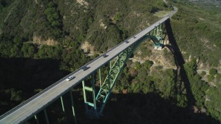 DFKSF01_051 - 5K stock footage aerial video of an orbit of the Cold Springs Canyon Arch Bridge, Santa Ynez Mountains, California