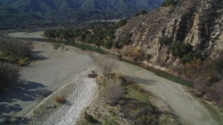 DFKSF01_055 - 5K stock footage aerial video of flying over dry riverbed, revealing Santa Ynez River, Santa Ynez Valley, California