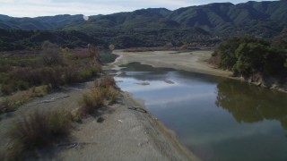 DFKSF01_056 - 5K aerial stock footage video of following the Santa Ynez River, Santa Ynez Valley, California