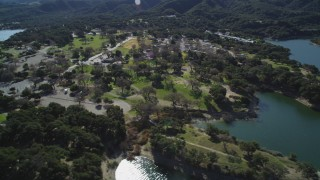 DFKSF01_059 - 5K stock footage aerial video of flying by a lakeside RV Park at Lake Cachuma, California