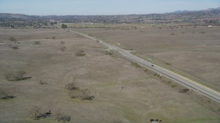 DFKSF01_064 - 5K stock footage aerial video of approaching a country highway and track a black SUV, Santa Ynez, California