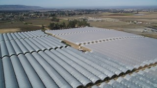 DFKSF02_003 - 5K stock footage aerial video of flying over greenhouses at a farm in Santa Maria, California