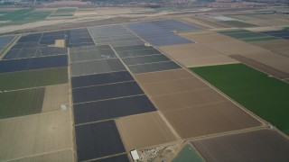 DFKSF02_011 - 5K stock footage aerial video of flying by fields of crops, rural landscape, Santa Maria, California