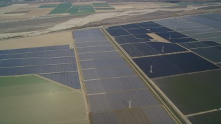 DFKSF02_012 - 5K stock footage aerial video of tilting to a bird's eye view of fields of crops, Santa Maria, California