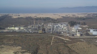 DFKSF02_017 - 5K stock footage aerial video of approaching Phillips 66 Company Santa Maria Refinery, Arroyo Grande, California