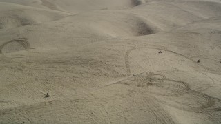 DFKSF02_021 - 5K stock footage aerial video of orbiting ATV riders cruising over the sand dunes, Pismo Dunes, California