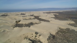 DFKSF02_022 - 5K stock footage aerial video fly over and pan across sand dunes, Pismo Dunes, California