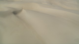 DFKSF02_025 - 5K stock footage aerial video of passing by the sand dunes, Pismo Dunes, California