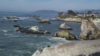 DFKSF02_040 - 5K stock footage aerial video of approaching coastal cliffs, revealing rock formations, Shell Beach, California