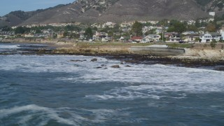 DFKSF02_042 - 5K stock footage aerial video of flying by oceanfront homes, Shell Beach, California