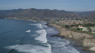 DFKSF02_045 - 5K stock footage aerial video fly over waves rolling toward coastal community of Shell Beach, California
