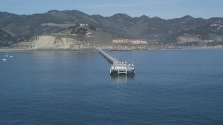 DFKSF02_051 - 5K stock footage aerial video of flying away from a pier, revealing coastline, Avila Beach, California