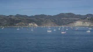 DFKSF02_052 - 5K stock footage aerial video of flying low by sailboats in San Luis Obispo Bay, Avila Beach, California