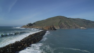 DFKSF02_053 - 5K stock footage aerial video pan across San Luis Obispo Bay, approach lighthouse, San Luis Obispo, California