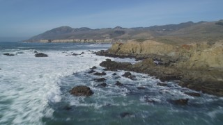 DFKSF02_059 - 5K stock footage aerial video of flying over waves and coastal cliffs, Avila Beach, California