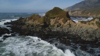 DFKSF02_064 - 5K stock footage aerial video fly over waves, rock formations, tilt to reveal coastal cliffs, Avila Beach, California
