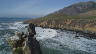 DFKSF02_065 - 5K stock footage aerial video fly over coastal cliffs, reveal rock formations off the coast, Avila Beach, California