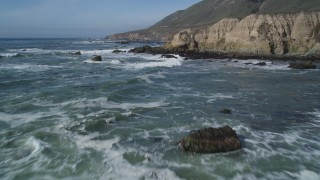 DFKSF02_066 - 5K stock footage aerial video of approaching coastal cliffs, rock formations, Avila Beach, California