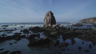 DFKSF02_068 - 5K stock footage aerial video of flying low past rock formations off the coast, Avila Beach, California