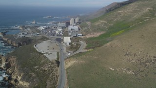 DFKSF02_071 - 5K stock footage aerial video of approaching the coastal Diablo Canyon Power Plant, Avila Beach, California