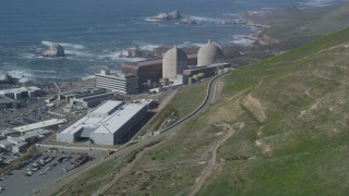 DFKSF02_072 - 5K stock footage aerial video of flying by the coastal Diablo Canyon Power Plant, Avila Beach, California