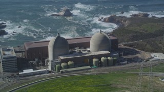 DFKSF02_073 - 5K stock footage aerial video of flying by the coastal Diablo Canyon Power Plant, Avila Beach, California