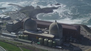 DFKSF02_074 - 5K stock footage aerial video of passing by the coastal Diablo Canyon Power Plant, Avila Beach, California