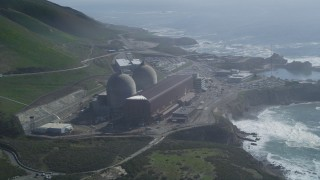 DFKSF02_075 - 5K stock footage aerial video of orbiting the coastal Diablo Canyon Power Plant, Avila Beach, California
