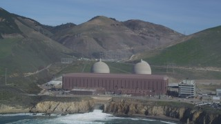 DFKSF02_077 - 5K stock footage aerial video of flying by the coastal Diablo Canyon Power Plant, Avila Beach, California