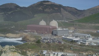 DFKSF02_080 - 5K stock footage aerial video tilt from ocean, reveal Diablo Canyon Power Plant nuclear facility, Avila Beach, California