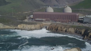 DFKSF02_081 - 5K stock footage aerial video of flying by the Diablo Canyon Power Plant nuclear facility, Avila Beach, California