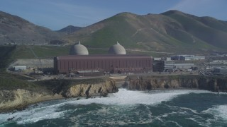DFKSF02_082 - 5K stock footage aerial video flyby Diablo Canyon Power Plant nuclear facility, seen from the ocean, Avila Beach, California